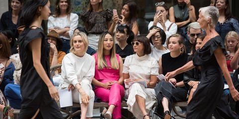 Eyewear, People, Trousers, Social group, Style, Crowd, Sitting, Fashion accessory, Street fashion, Fashion,