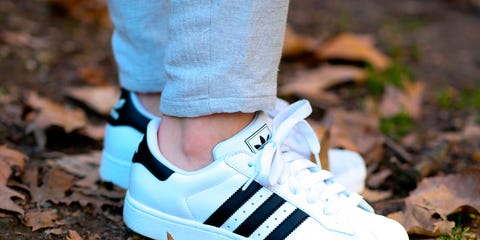 Footwear, Shoe, Green, People in nature, Athletic shoe, Azure, Electric blue, Sneakers, Soil, Grey,