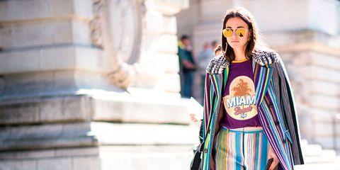 Street fashion, Costume design, Sunglasses, Fashion model, Shadow, Mantle, Costume, Fashion design, Vintage clothing,