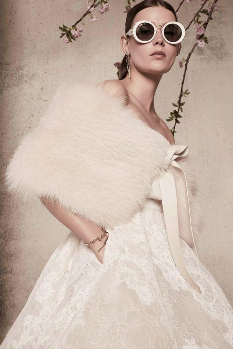 Clothing, Wedding dress, Dress, Shoulder, Skin, Beauty, Eyewear, Gown, Bride, Fur,