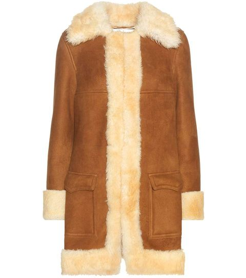Brown, Sleeve, Coat, Textile, Fur clothing, Outerwear, Natural material, Tan, Jacket, Fashion,