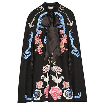 Sleeve, Textile, Fashion, Costume design, Costume, Clothes hanger, Visual arts, Creative arts, Mantle, Pattern,