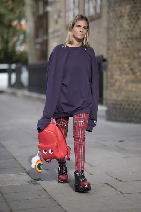 Clothing, Sleeve, Outerwear, Street fashion, Toy, Carmine, Knee, Rolling, Long hair, Skating,