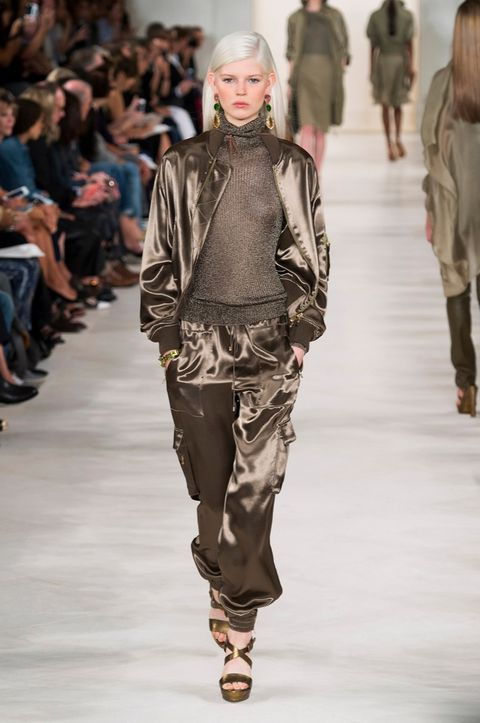 Clothing, Footwear, Leg, Brown, Trousers, Fashion show, Shoulder, Joint, Outerwear, Runway,