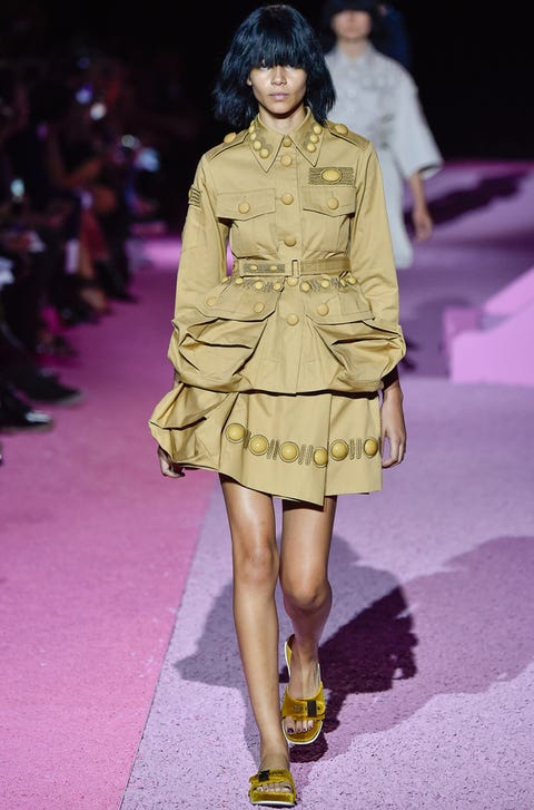 Clothing, Human, Yellow, Event, Shoulder, Fashion show, Human leg, Textile, Joint, Outerwear,