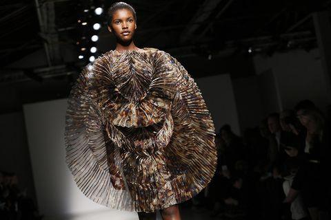 Fashion, Sculpture, Fashion design, Fashion model, Natural material, Earrings, Haute couture,
