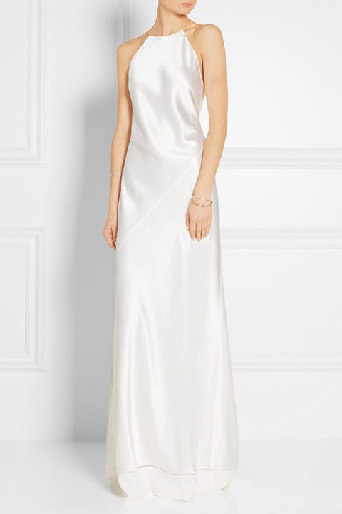Clothing, Sleeve, Shoulder, Dress, Joint, White, Standing, Formal wear, Style, Elbow,