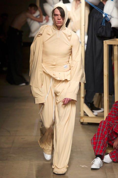 Footwear, Shoe, Standing, Fashion, Costume design, Beige, Costume, Waist, Street fashion, Fashion model,