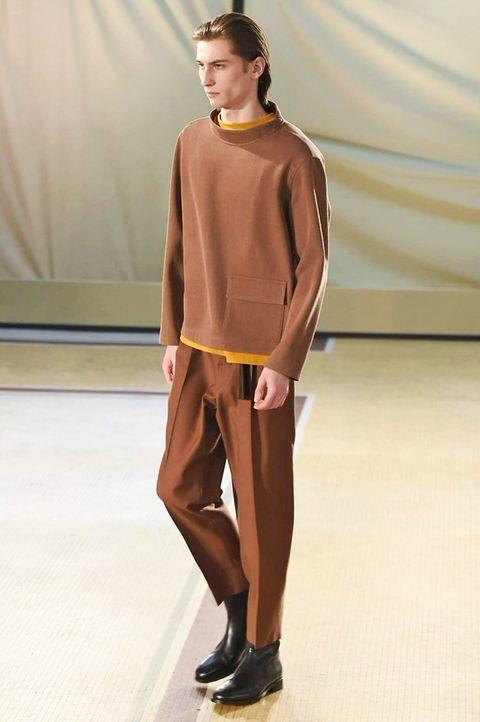 Footwear, Brown, Sleeve, Trousers, Shoe, Human leg, Standing, Style, Fashion show, Knee,