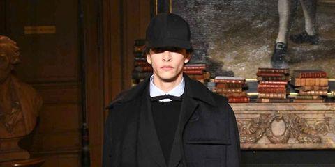 Hat, Outerwear, Formal wear, Style, Coat, Collar, Headgear, Blazer, Costume accessory, Overcoat,