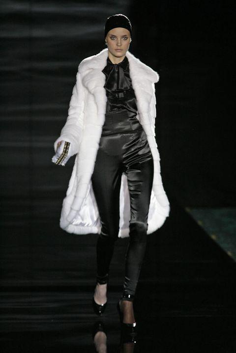 Fashion show, Outerwear, Runway, Style, Fashion accessory, Hat, Costume design, Fashion model, Fashion, Jacket,