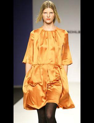 Sleeve, Style, Dress, Fashion show, Fashion model, Orange, Fashion, Street fashion, One-piece garment, Costume design,