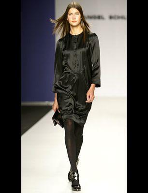 Clothing, Hairstyle, Sleeve, Fashion show, Shoulder, Dress, Human leg, Joint, Runway, Fashion model,