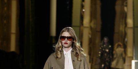 Eyewear, Vision care, Sleeve, Fashion show, Outerwear, Sunglasses, Style, Coat, Street fashion, Fashion model,