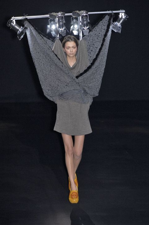 Style, Fashion, Black, Costume design, Fashion design, Fashion model, Silver, One-piece garment, Ankle, Haute couture,