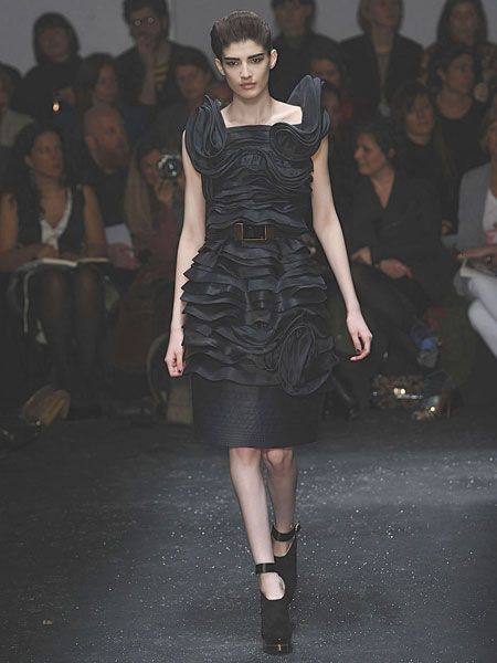 Clothing, Event, Fashion show, Human body, Shoulder, Dress, Joint, Outerwear, Runway, Style,