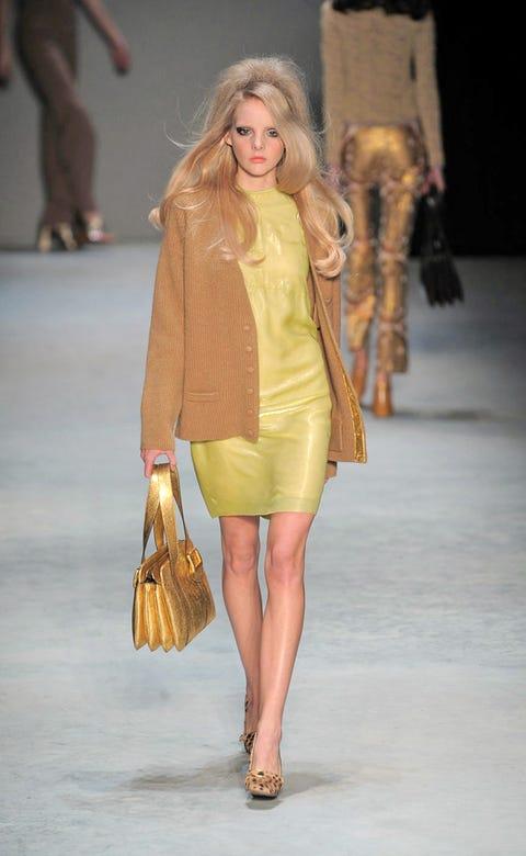 Footwear, Leg, Brown, Yellow, Shoulder, Human leg, Textile, Fashion show, Joint, Outerwear,