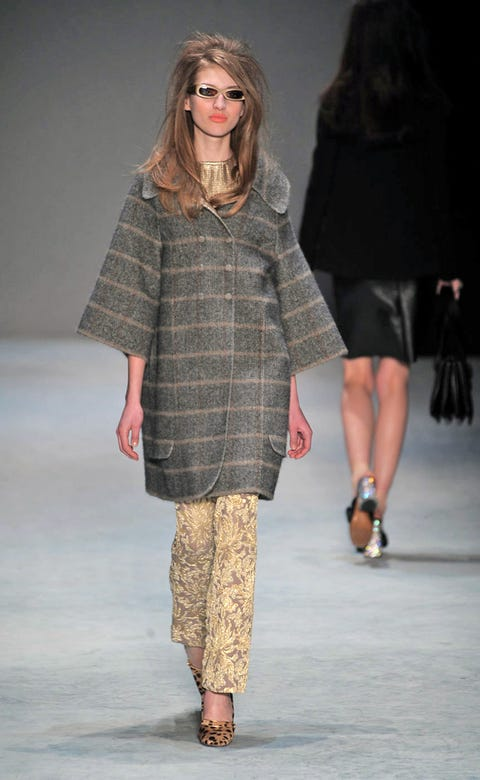 Clothing, Leg, Brown, Fashion show, Sleeve, Human body, Shoulder, Winter, Textile, Joint,