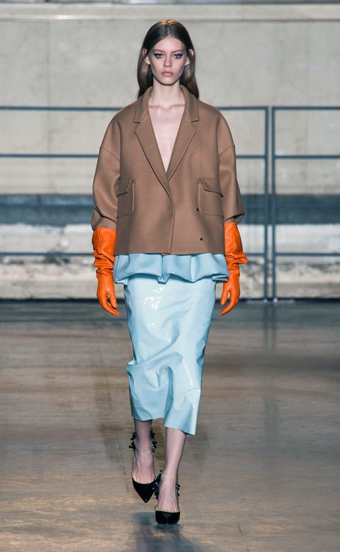 Clothing, Brown, Sleeve, Human body, Fashion show, Textile, Joint, Outerwear, Style, Runway,