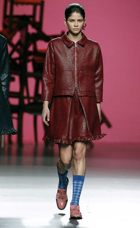 Fashion show, Sleeve, Human body, Shoulder, Runway, Joint, Human leg, Outerwear, Red, Fashion model,