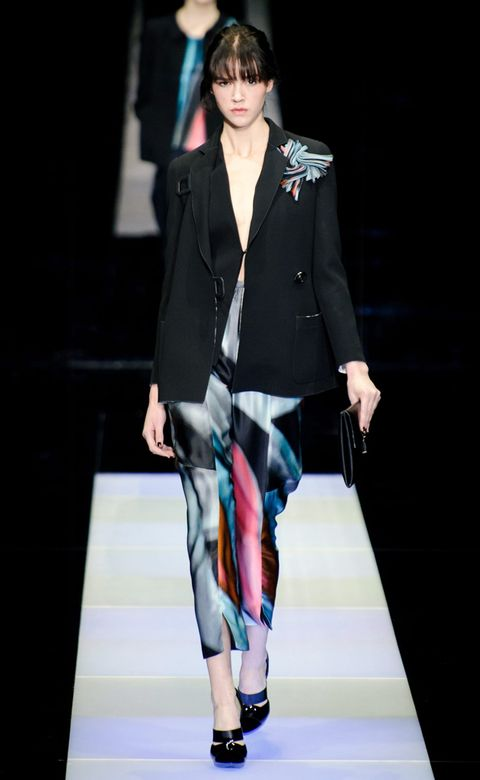 Clothing, Human leg, Fashion show, Joint, Outerwear, Coat, Style, Runway, Fashion model, Knee,
