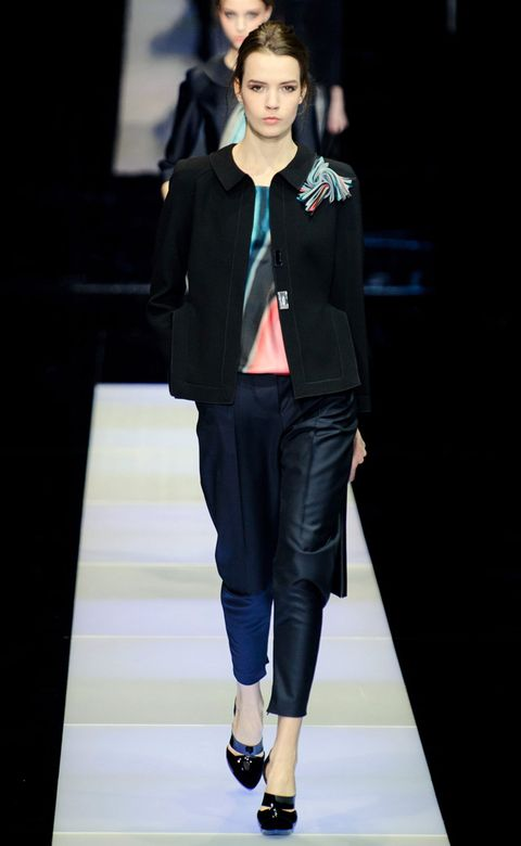 Clothing, Footwear, Shoulder, Joint, Outerwear, Human leg, Fashion show, Style, Coat, Runway,