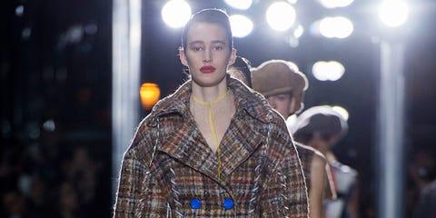 Fashion show, Sleeve, Human body, Textile, Plaid, Pattern, Fashion model, Runway, Street fashion, Tartan,