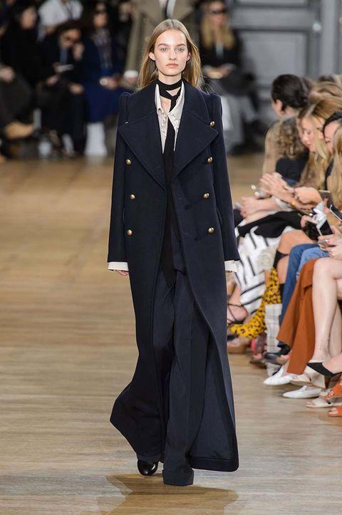 Clothing, Coat, Outerwear, Style, Formal wear, Fashion show, Fashion model, Street fashion, Blazer, Suit,