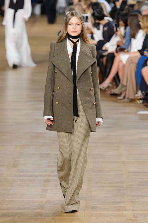 Human, Leg, Sleeve, Shoulder, Fashion show, Coat, Joint, Outerwear, Fashion model, Style,