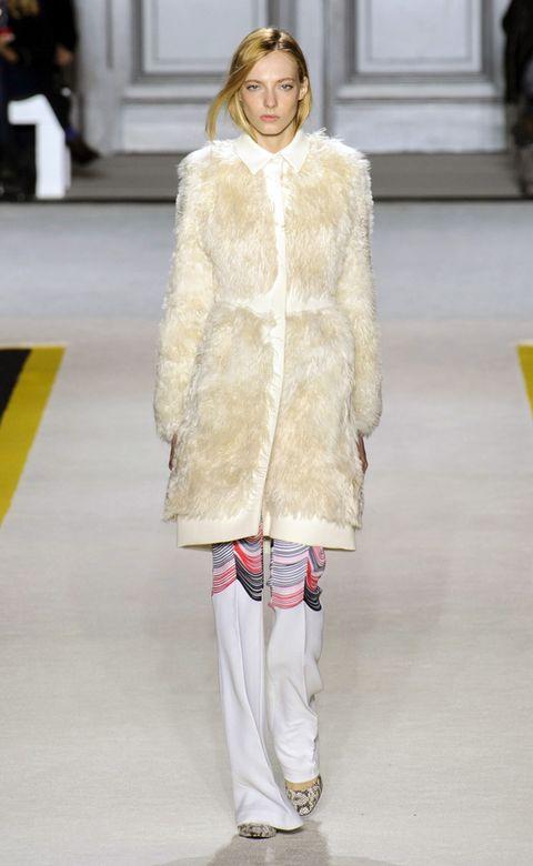 Yellow, Shoulder, Textile, Fashion show, Outerwear, Style, Fashion model, Winter, Street fashion, Runway,