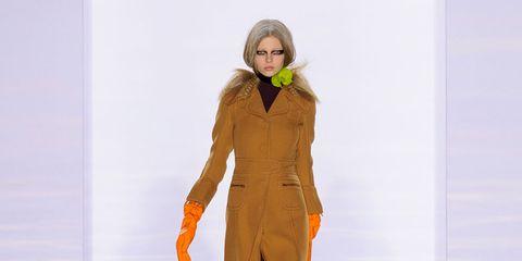 Sleeve, Shoulder, Joint, Fashion show, Style, Costume design, Fashion model, Fashion, Runway, Orange,