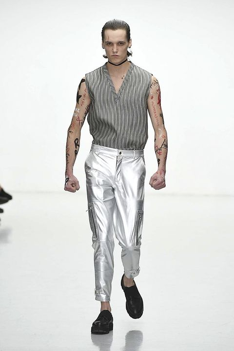 Clothing, Sleeve, Human body, Trousers, Collar, Shoulder, Shirt, Textile, Joint, Standing,
