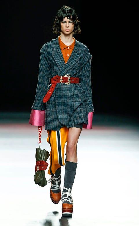 Clothing, Human, Fashion show, Shoulder, Joint, Outerwear, Human leg, Runway, Style, Fashion model,