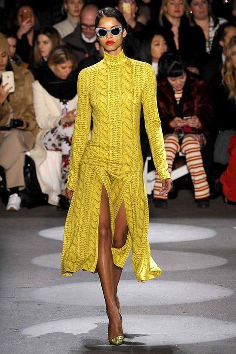 Clothing, Eyewear, Footwear, Human, Vision care, Yellow, Fashion show, Runway, Outerwear, Style,