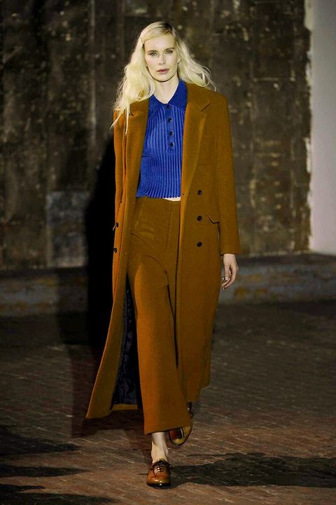 Sleeve, Coat, Textile, Outerwear, Collar, Street fashion, Blazer, Fashion, Fashion model, Fashion show,
