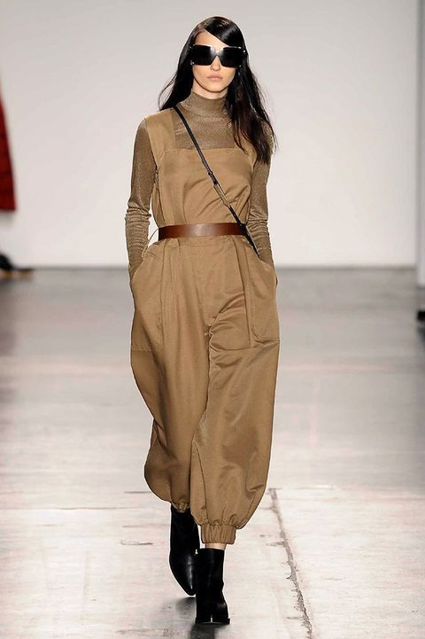 Clothing, Eyewear, Vision care, Brown, Sleeve, Fashion show, Shoulder, Joint, Dress, Style,