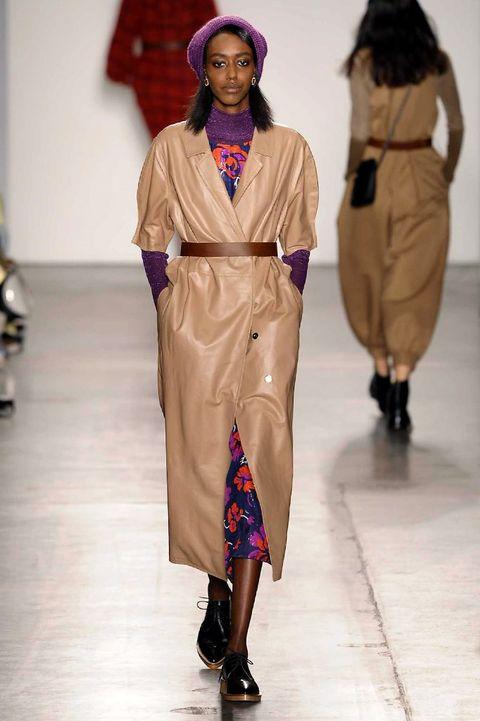 Footwear, Headgear, Fashion, Beige, Fashion show, Sandal, Runway, Fashion model, Fashion design, Costume design,