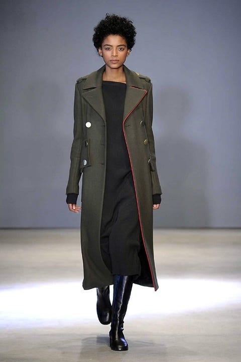 Sleeve, Human body, Textile, Joint, Fashion show, Outerwear, Coat, Style, Fashion model, Jacket,