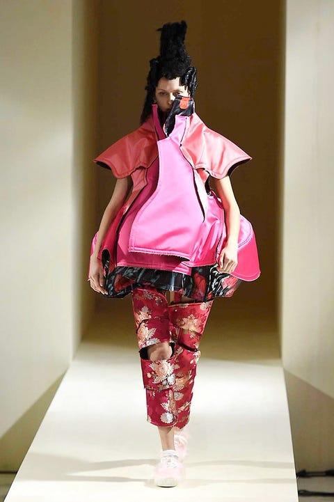 Textile, Style, Pink, Magenta, Fashion, Costume accessory, Costume design, Fashion design, Costume, Visual arts,