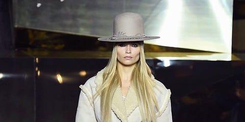 Clothing, Sleeve, Textile, Hat, Outerwear, Fashion show, Coat, Fashion model, Style, Street fashion,