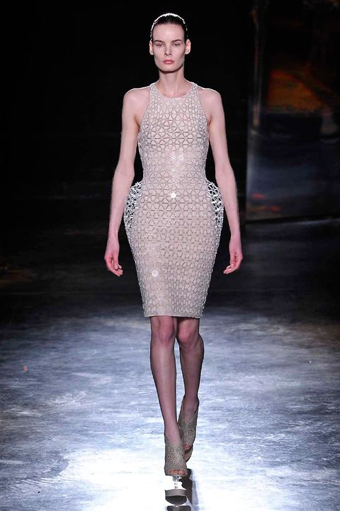 Leg, Fashion show, Shoulder, Dress, Joint, Runway, Fashion model, Style, Waist, One-piece garment,