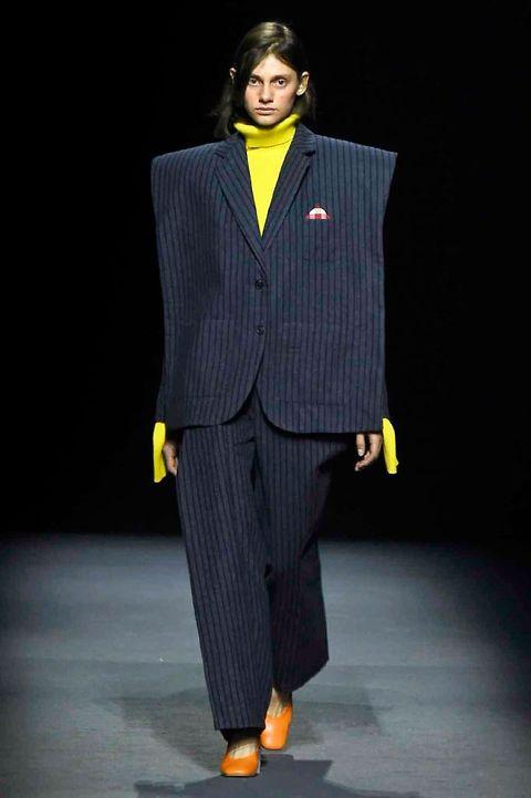 Yellow, Collar, Sleeve, Human body, Coat, Dress shirt, Outerwear, Formal wear, Style, Blazer,
