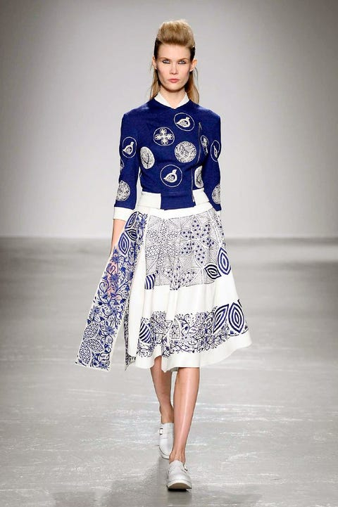 Clothing, Blue, Sleeve, Shoulder, Fashion show, Joint, Style, Runway, Fashion model, One-piece garment,
