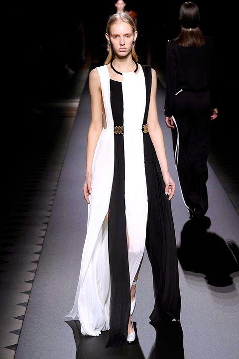 Fashion show, Shoulder, Outerwear, Runway, Dress, Style, Fashion model, Formal wear, Fashion, Model,