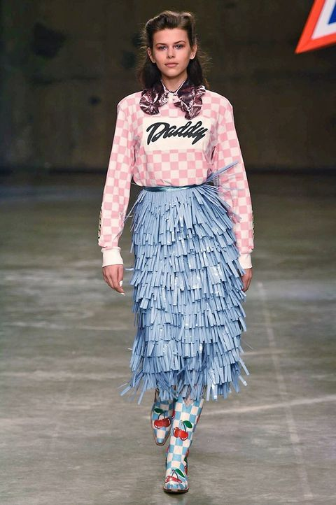 Clothing, Flag, Sleeve, Shoulder, Fashion show, Textile, Joint, Style, Pattern, Street fashion,