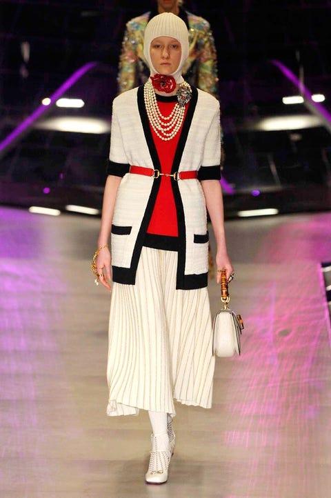 Outerwear, Fashion show, Style, Fashion accessory, Street fashion, Headgear, Fashion, Bag, Winter, Fashion model,