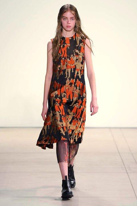 Clothing, Fashion show, Shoulder, Joint, Fashion model, Runway, Style, Dress, One-piece garment, Orange,