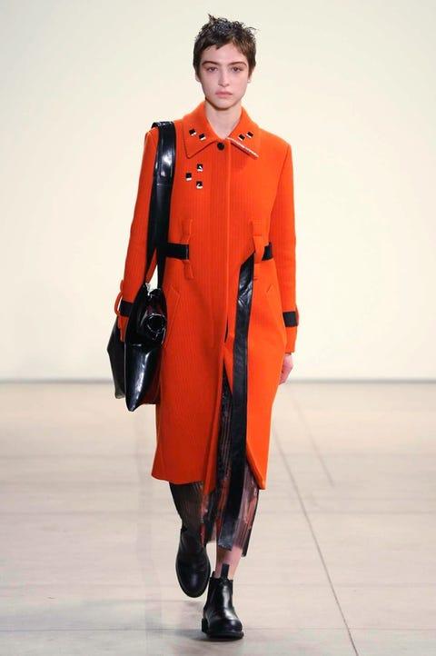 Collar, Joint, Style, Uniform, Blazer, Fashion, Fashion model, Orange, Costume design, Bag,