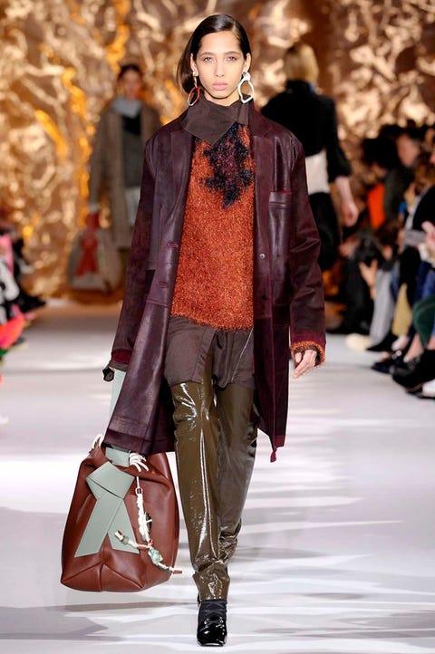 Fashion model, Fashion, Fashion show, Runway, Clothing, Street fashion, Outerwear, Leather, Footwear, Human,