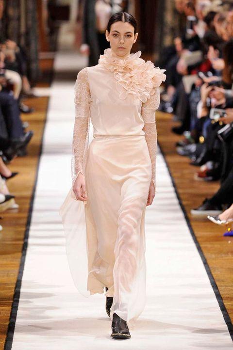Fashion show, Event, Shoulder, Runway, Outerwear, Fashion model, Style, Waist, Model, Fashion,